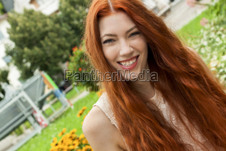 attractive young woman with long red