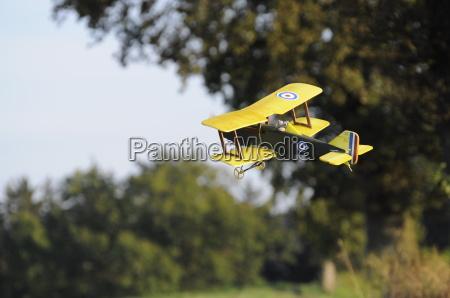 a model plane a biplane flies