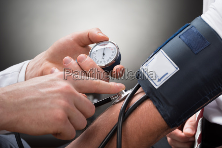 doctor checking blood pressure of a