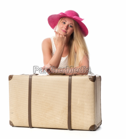 young woman with straw hat leaning