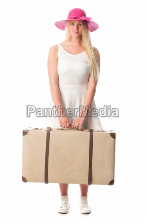 girl with hat carrying a suitcase