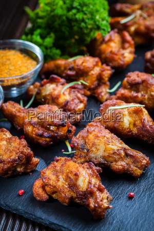 ali di pollo con spezie ed