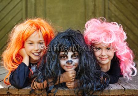 happy girls in wigs