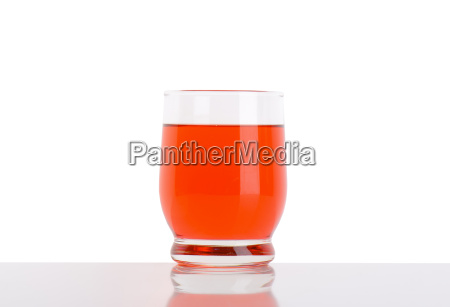 glass of strawberry juice on white