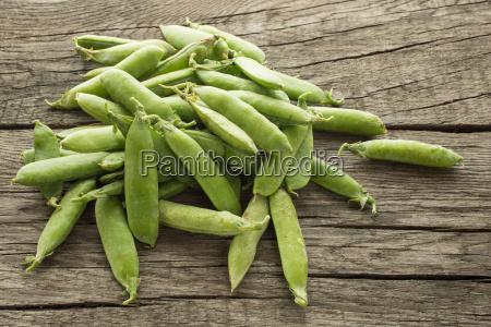 cibo legno controluce verdura piselli legume