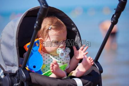 ritratto del bambino in carrozza