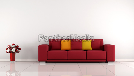 minimalist living room with red sofa