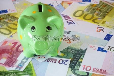 banconote verdi in materia di piggy