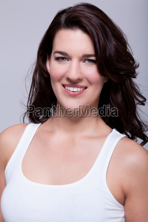 attractive laughing young woman with long