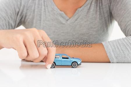 women holding model car leasing business