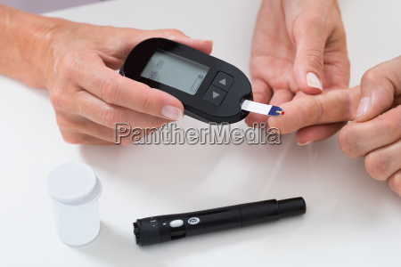 doctor measuring sugar reading of patient