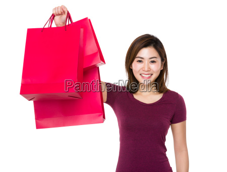 young woman holding up with shopping