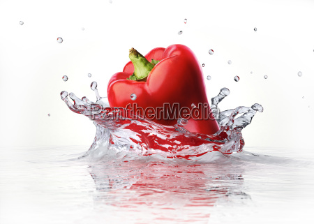 red sweet bell pepper falling and
