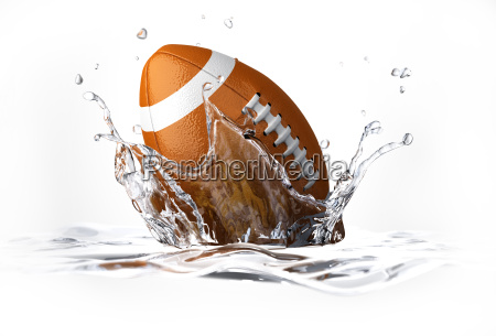 american football ball falling into clear
