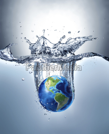 planet earth splashing into water