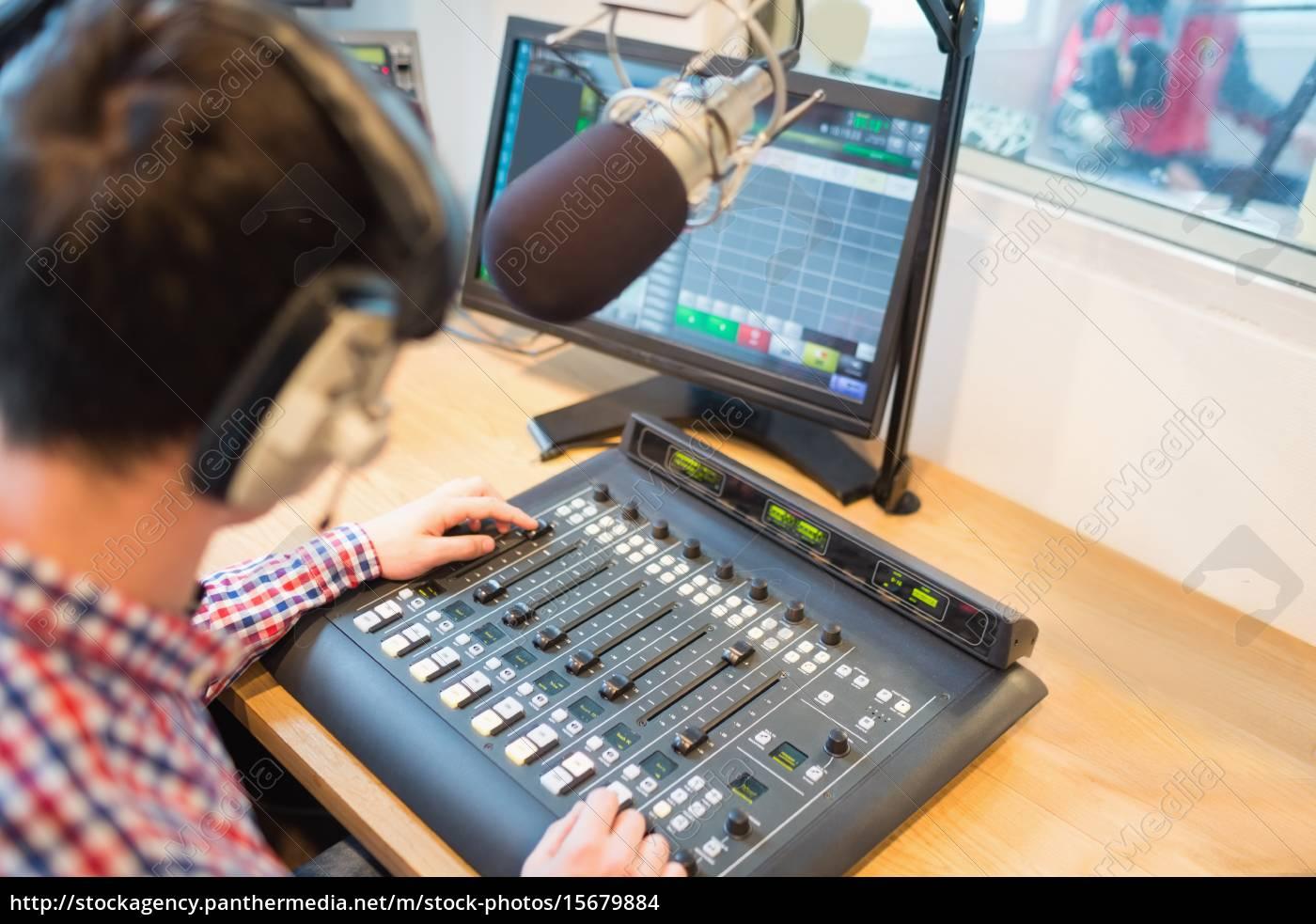 high, angle, view, of, radio, host - 15679884