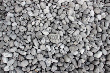 grey rubble beach pebblestones in prospettiva