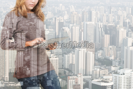 double exposure of woman using tablet