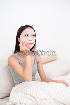 woman use of the paper mask