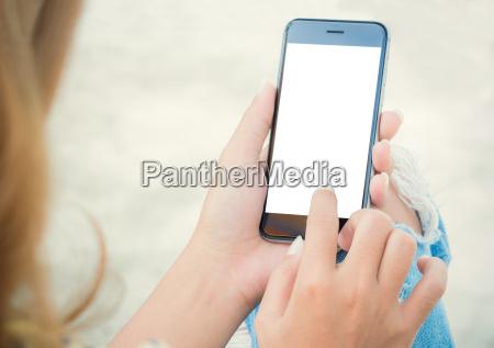 closeup women using phone from back