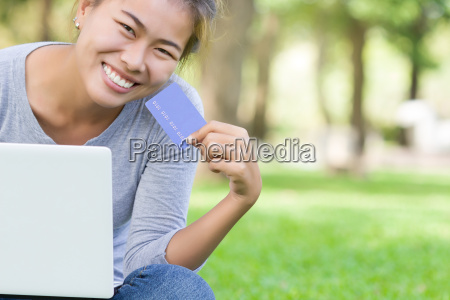 happy woman with credit card and