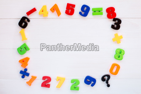 numbers laid on wooden background