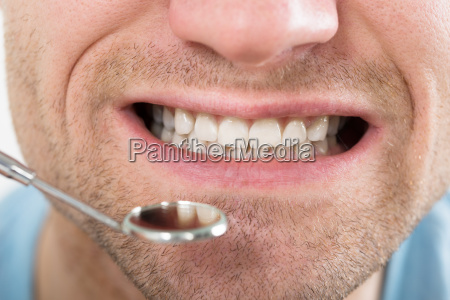 man teeth and dentist mouth mirror