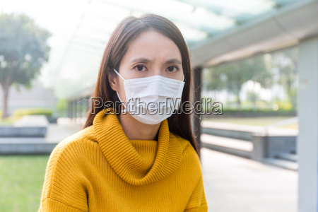 asian woman wearing face mask for