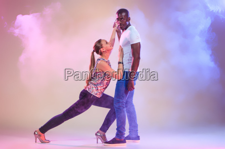young couple dances social caribbean salsa