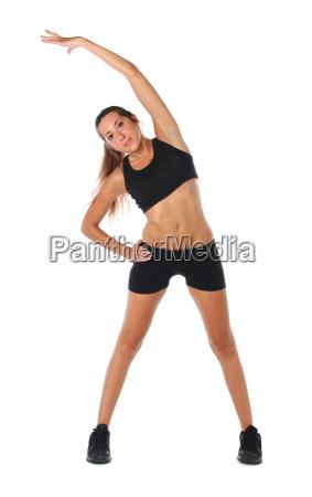 felice giovane donna tenendo facendo esercizio