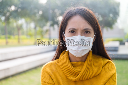 asian young woman wearing the face