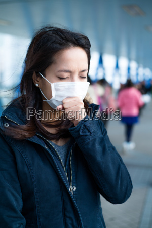 asian woman wear face mask for