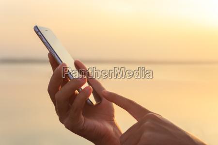 closeup hand using phone during at