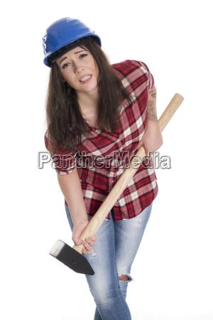 female artisans carrying a heavy sledgehammer