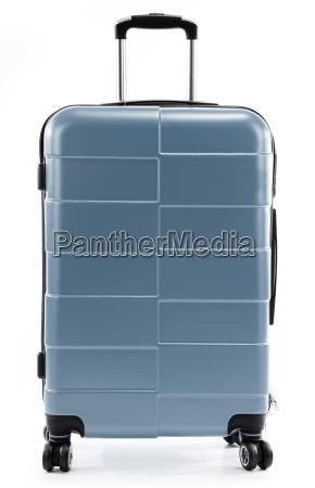 grande valigia di viaggio rosso isolato