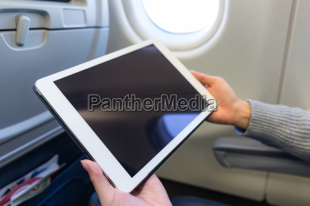 woman use of tablet pc inside
