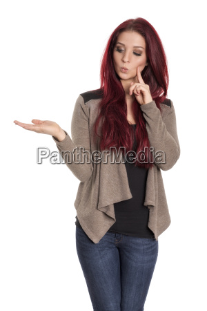 contemplative red haired girl is pointing