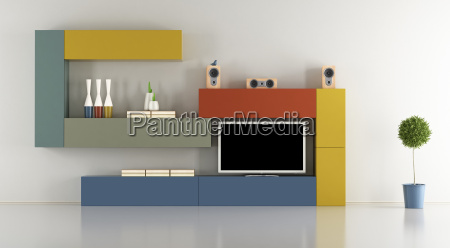 minimalist lounge with colorful wall unit