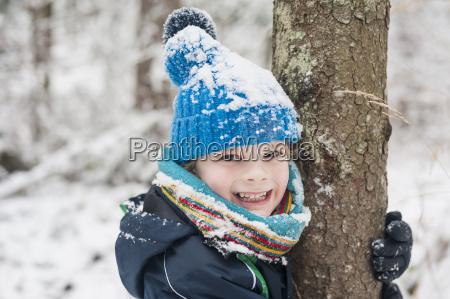 portrait of happy boy in winter