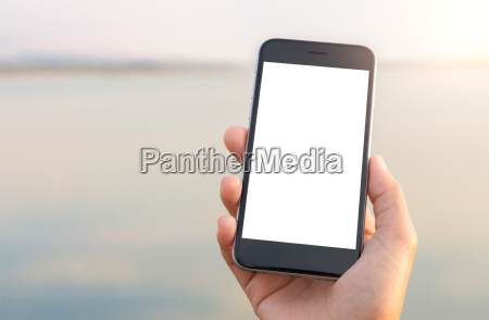 hand holing phone white screen at