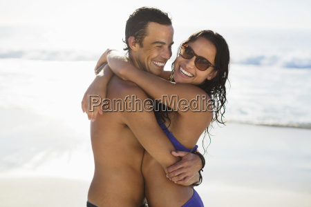 portrait of happy couple hugging on