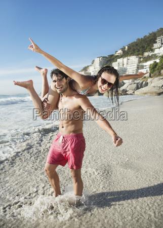 portrait of happy man lifting woman