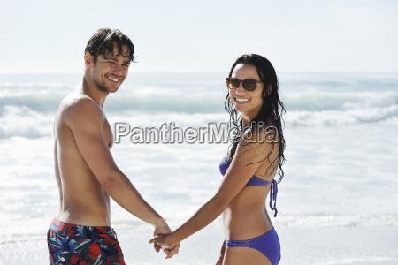 portrait of happy couple holding hands