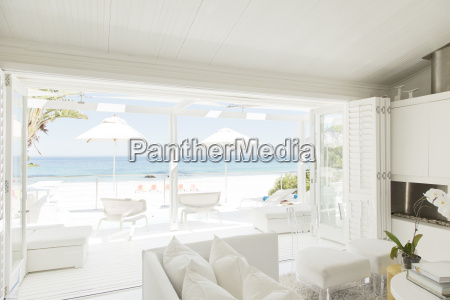modern living room overlooking beach and