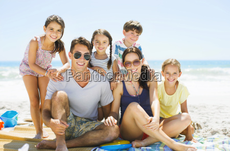 portrait of smiling family on beach