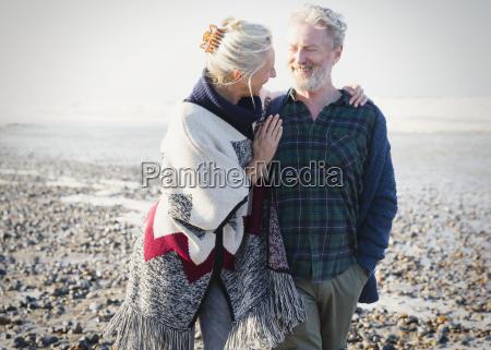 senior couple hugging and walking on