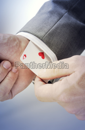 business man playing card with heart