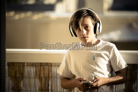 portrait of boy listening music with