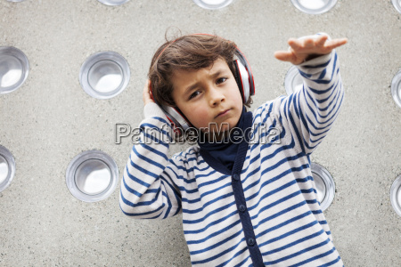 portrait of little boy rapping while