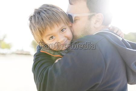 portrait of smiling little boy hugging